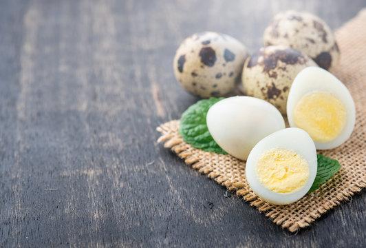 Boiled quail eggs on wood table