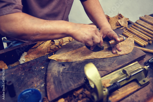 closeup of hands making cigar from tobacco leaves traditional manufacture of cigars dominican. Black Bedroom Furniture Sets. Home Design Ideas