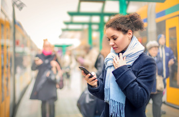 Girl checking her smartphone
