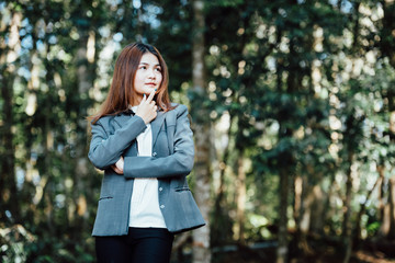 business woman think something standing area forest