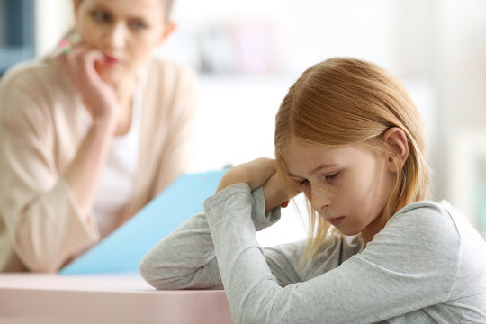 Sad teenager girl in child psychologist's office