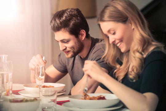 Cute couple eating dinner