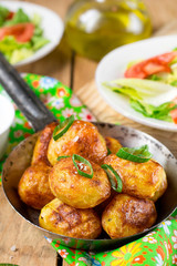Roasted baby potatoes with butter, salt and chives