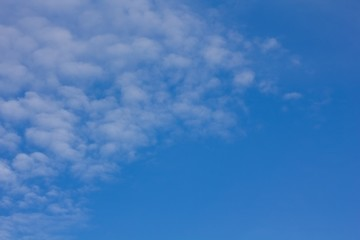 Pure blue sky with clouds.