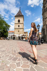 Girl in front of the The Urban Tower in Kosice in Slovakia