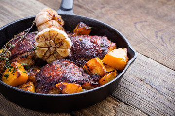 Roasted  chicken thighs with with butternut, thyme and garlic