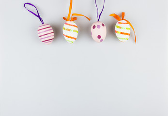 Happy easter greetings card with coloured eggs isolated on a white background