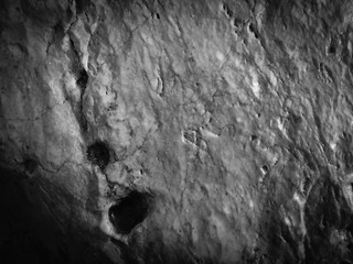 Black stone natural texture background surface, close up image