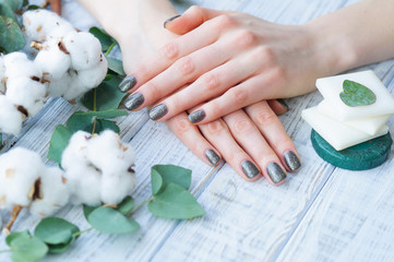 Woman hands with olive green manicure on fingernails, beauty treatment with natural cosmetics