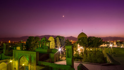 Panorama view over the roof's of Kashan by night with moon