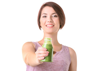 Young beautiful woman with green smoothie on light background