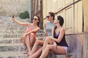 Fashionable girls doing a selfie