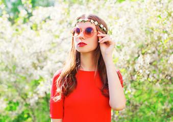 Fashion portrait beautiful hippie woman over flowering garden background