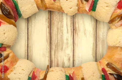 """Rosca De Reyes Frame With Wooden Background"" Stock Photo"