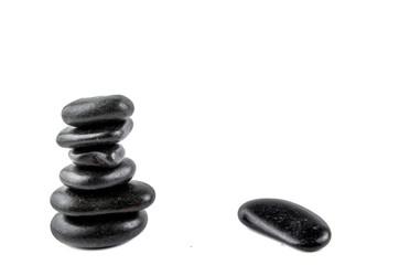 Stacked black zen stone isolated on white
