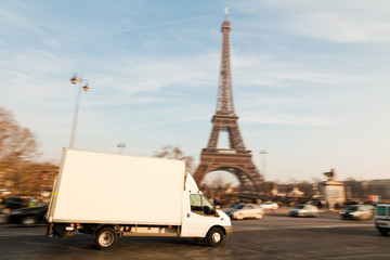White Delivery Van At The Eiffel Tower