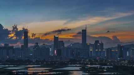 Skyline of Shenzhen City, China at dusk. Viewed from Hong Kong border