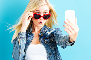Young woman taking a selfie