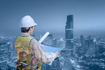 Double exposure Construction engineer checking construction drawing with modern cityscape for new Infrastructure construction project concept