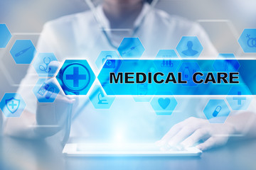 Medical doctor using tablet PC with medical care medical concept.