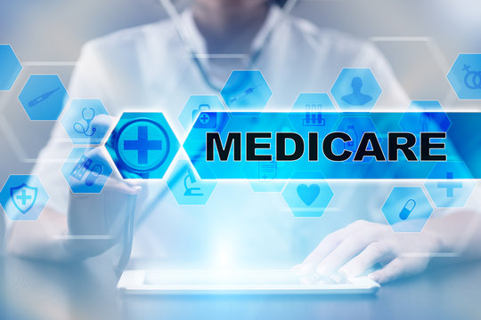 Medical doctor using tablet PC with medicare medical concept.