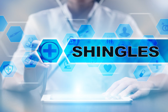 Medical doctor using tablet PC with shingles medical concept.