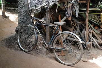 Foto op Plexiglas Fiets Old bike in a Ceylon village.