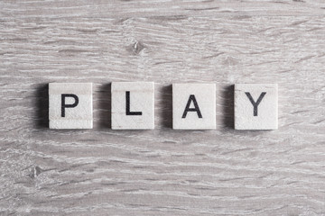 wooden elements with letter collected to word play