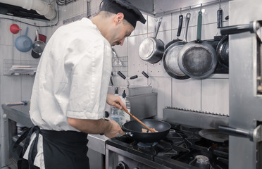 chef cooking pan meat