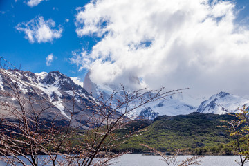 Landscape with the lake Capri in Patagonia with the view on Fitz Roy mountain covered with snow and clouds.
