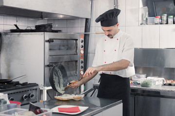 chef making cooking sandwich pan
