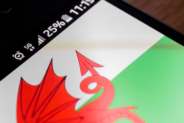 Smartphone 5G network 25 per cent charge and Wales flag