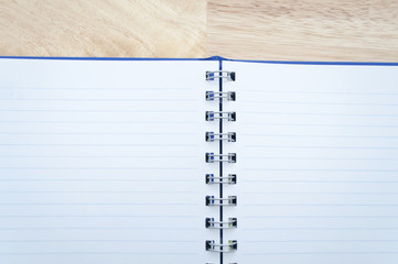 notebook on wooden table, view from above