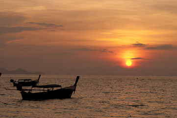 blurred of silhouette Traditional longtail boat on the sea at sunset light
