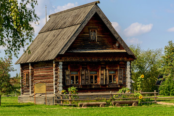 Old wooden rustic house a sunny summer day.