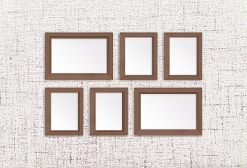 Collage of wooden photo frames on textured wallpaper background, interior decor mock up