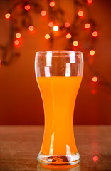 Cold glass of beer on light background