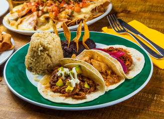 Mexican tacos served with rice and frijoles