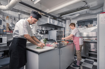 two people cooking, commercial kitchen