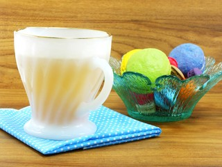 cup of tea with sweet and colorful french macaroons