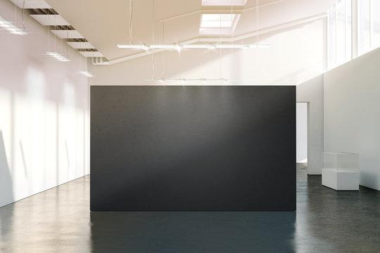 Blank black wall mockup in sunny modern empty gallery,