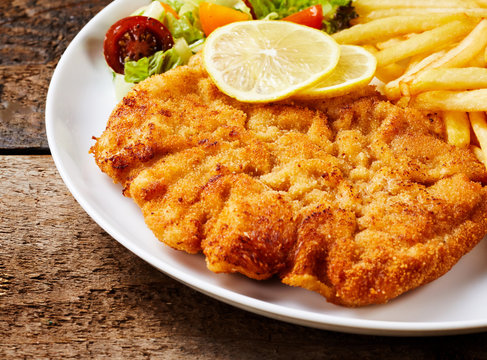 Schnitzel with French fries close-up