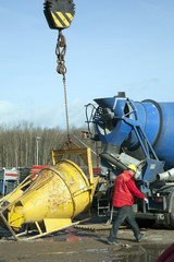 blue cement truck unloading on constyruction site