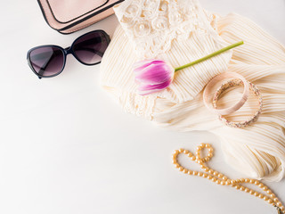 Woman clothes accessories fashion shopping. Romantic dress outfit with glasses and necklace bracelets. Summer elegant style look flat lay for blog lifestyle on white background