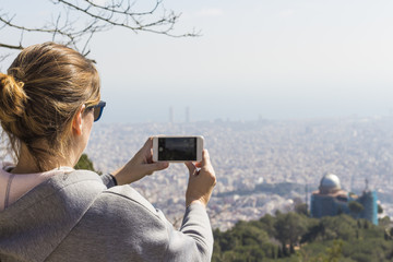Woman making photos in Barcelona