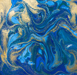 Blue and gold liquid texture. Hand drawn marbling background. Ink marble abstract pattern