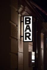 Bar vertical signage outside a building