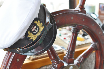 Captain's hat on steering wheel.