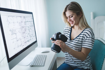 Designer and photographer woman looking at camera