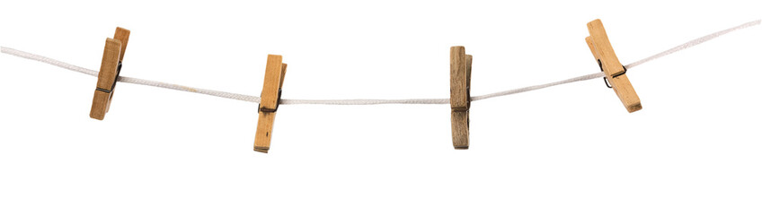 Old wooden clothespins on a rope isolated on  background